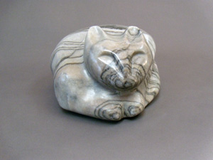 Marble cat sculpture by Aaron Poovey.